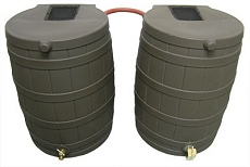 Shown here: Two Recycled Black Rain Mizer Rain Barrels linked together with optional Linking Kit